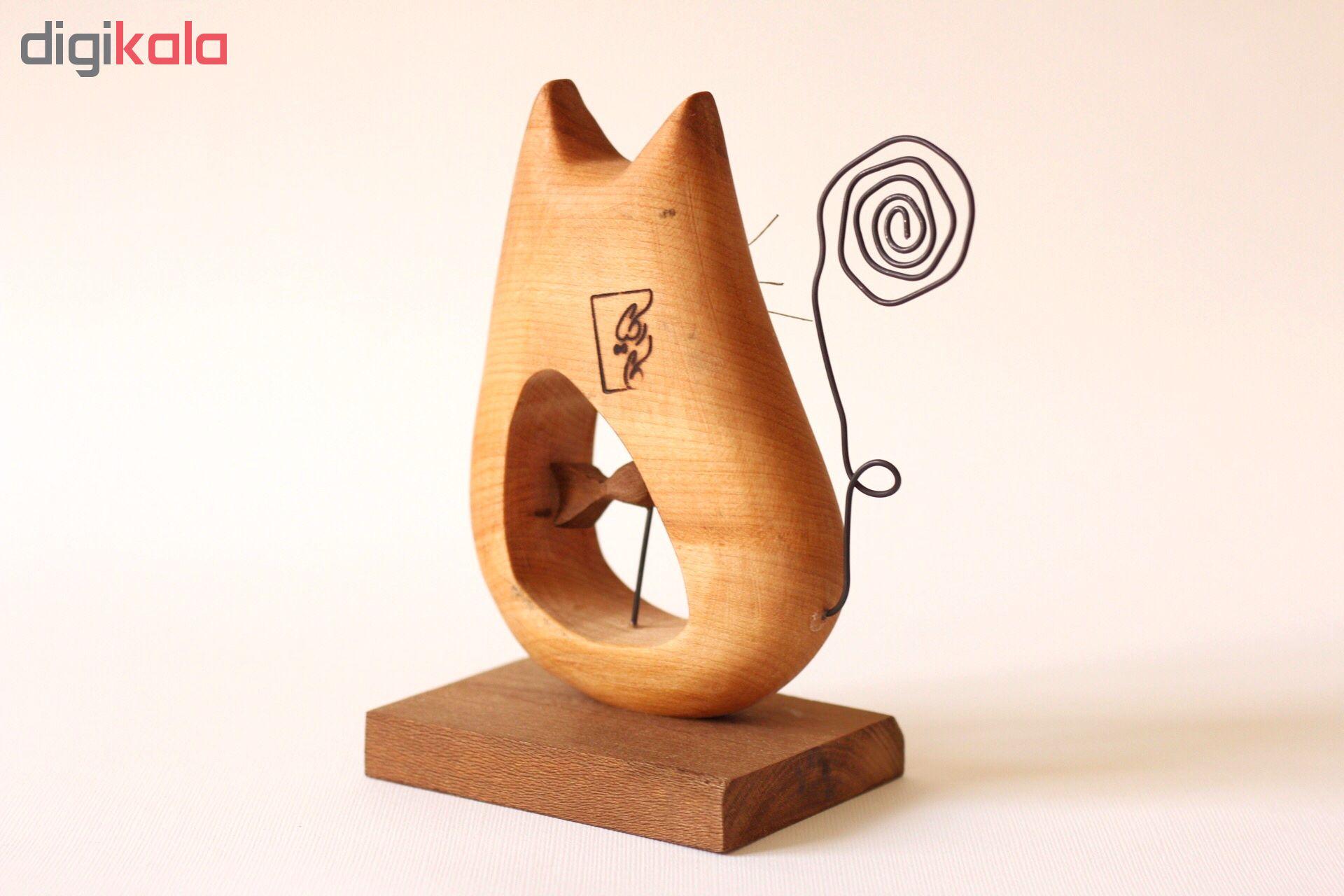 خرید                      مجسمه کارکیا طرح گربه و ماهی کد W05