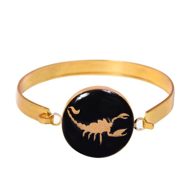 دستبند طلا 24 عیار زنانه طرح نماد ماه آبان کد 1255