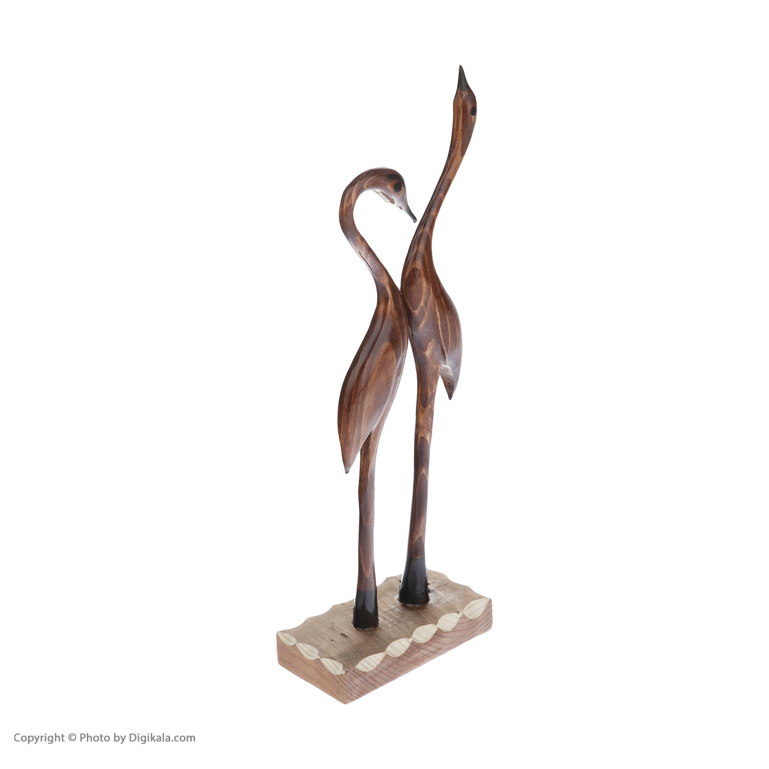 خرید                      مجسمه چوبی مدل لک لک عاشق کد 0027-40