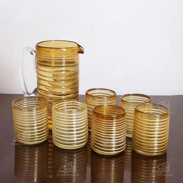 ست پارچ و لیوان شیشه گری فوتی ساده زرد طرح موج مدل 1020500001