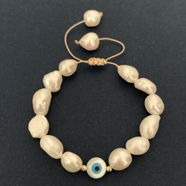 دستبند طلا 18 عیار زنانه الماسین آذر طرح گوی کد CHESHMNA05