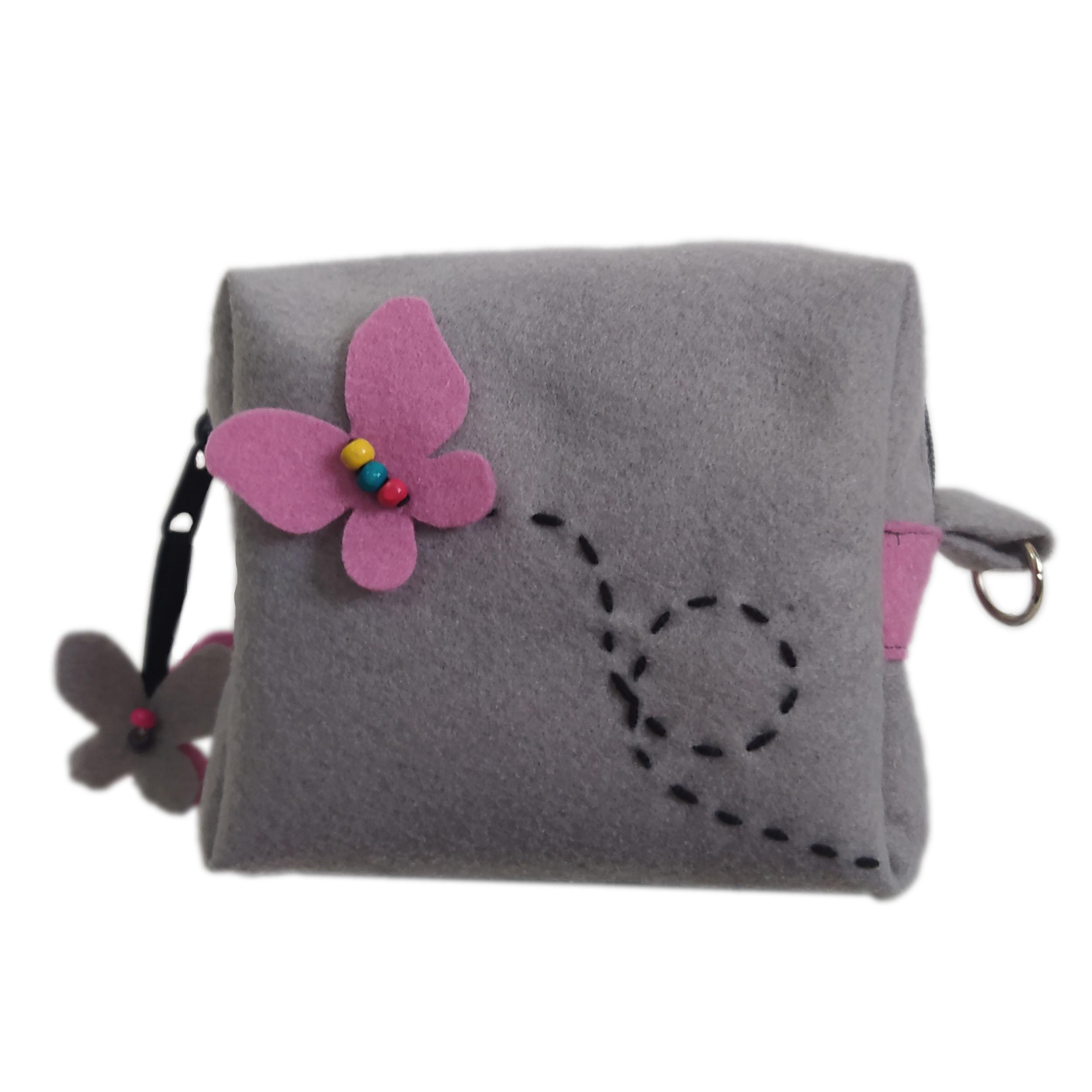 خرید                      کیف نمدی مدل پروانه